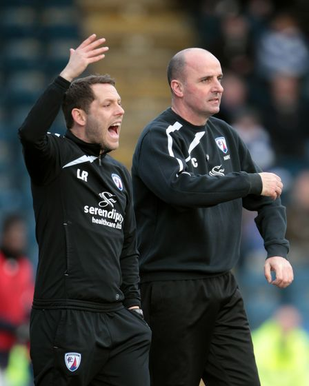 Chesterfield's manager Paul Cook (right) and assistant Leam Richardson (left) gesture on the touchli