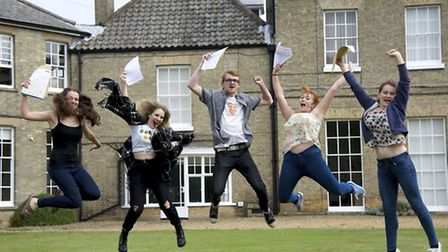 A-Level Results day at Paston College Lawns Site in North Walsham. Jumping for Joy from left Pryce B