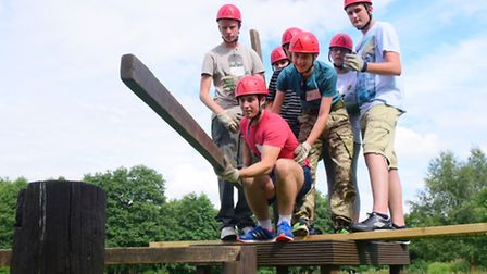 Young people who are interested in a future in engineering attend a week-long course includes team b