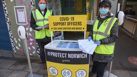 COVID-19 support officers Rodney Eastwood and Alison Darling at their Norwich Market stand. Picture: