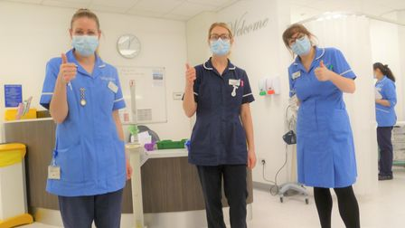 Three staff of the Weybourne Day Unit of the Norfolk and Norwich Hospital giving a thumbs up