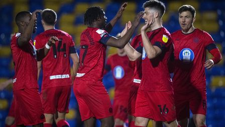 Wigan's Jamie Proctor (second right) celebrates scoring his side's first goal with his teammates dur
