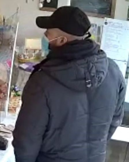 CCTV image of one of four men police want to identify in connection with an aggravated burglary .