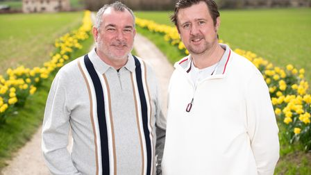 Dave and Vance Taylor on their beautiful drive lined with daffodils. Picture: Sarah Lucy brown