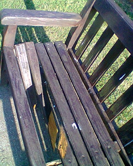 A vandalised bench at the park.