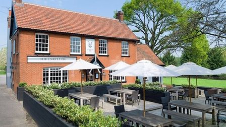 The Unruly Pig has a sunny decked terrace and large lawn Picture: Tim Bowden