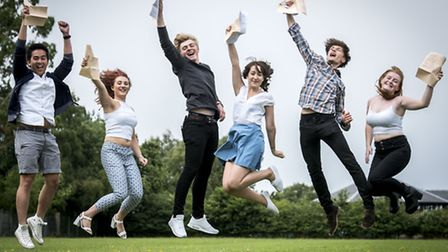 An excellent example of students jumping for joy for the camera - pupils at Springwood High School i
