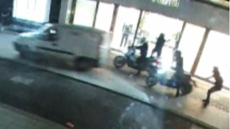 Robbery in progress... the moment a security guard reverses van intogang's motorbikes and foils raid