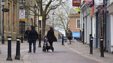 A few people out and about in Bury St Edmunds before the Covid restrictions are eased. Picture: DENI