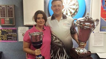 Roz Bulmer and Jason Lovett show off their silverware from Leicester.