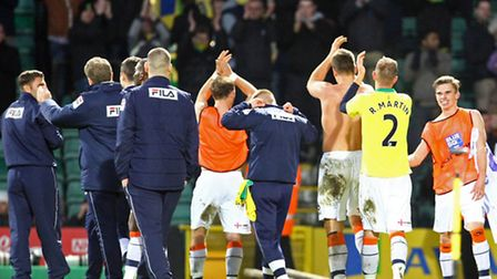 Luton players celebrate their cup upset at Carrow Road in January 2013. Picture by Paul Chesterton/F