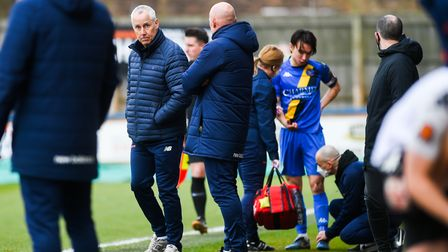 King's Lynn Town boss Ian Culverhouse and captain, Michael Clunan injured in the background