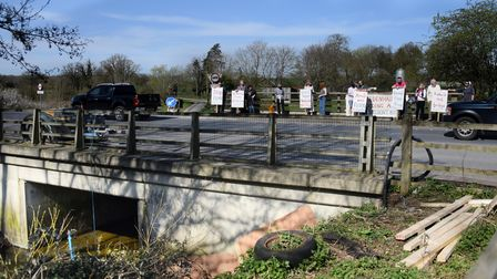 Redenhall Flood Group with their banners at the bridge on the A143 over the Starston Beck as they as