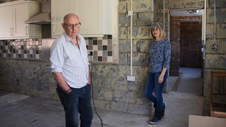 Redenhall residents Roger and Linda Walsh, part of the Redenhall Flood Group, inside their home floo