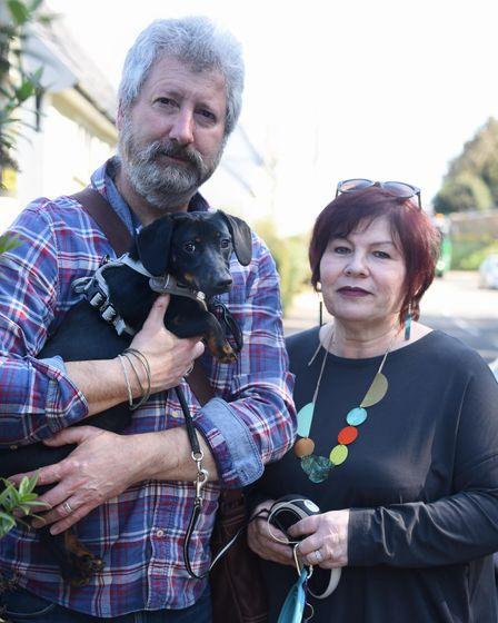 Redenhall residents David and Jayne Gittins and their puppy Molly, part of the Redenhall Flood Group