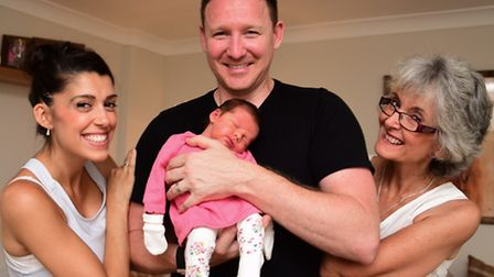Claire and Jamie Barnard with their four-day-old daughter, Marcie, who arrived in hurry at their hom
