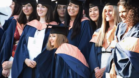 Students pose for a photograph after one of the UEA graduation ceremonies in 2016.
