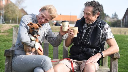 Customers Jana and Steve with their dog Brandy, enjoying a cup of coffee from the Caféon the Rec