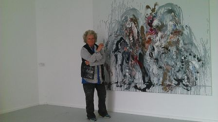 Maggi Hambling with one of her large Wall of Water paintings