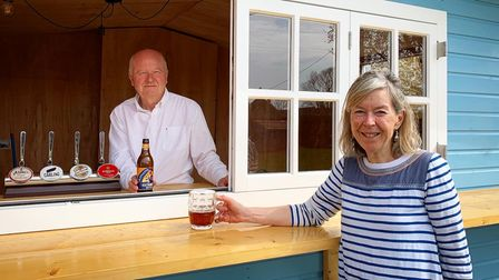 Owners Anthony and Jeannette Goodrich with The Rose & Crown's new outdoor beach hut bar.