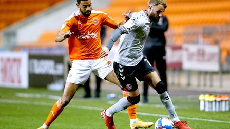 Blackpool's CJ Hamilton (left) and Charlton Athletic's Andrew Shinnie battle for the ball during the