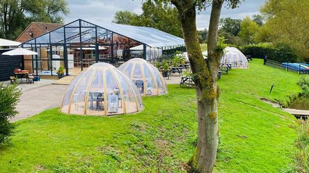 The orangery and dining pods by the river at The Anchor Inn, Nayland, Suffolk