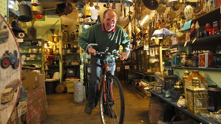 Well-known Sheringham shopkeeper retires and sets off on epic cycling journeys. Mike Crowe, owner of