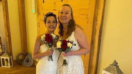 Naomi Roberts (left) and Georgina Fisher on their wedding day earlier this year