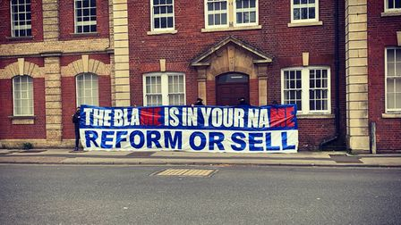 Supporters from Blue Action are calling for Marcus Evans to reform or sell Ipswich Town FC