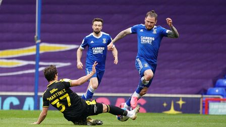 James Norwood starts to go on a run as Pablo Mart'nez looks to block.