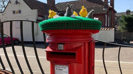 This Leiston postbox was given a crochet 'hat' by mystery yarnbombers