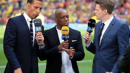 Ian Wright, centre, flanked by Rio Ferdinand, left, and Jake Humphrey for BT Sport. Picture: Nick Po