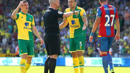 Russell Martin argues with referee Simon Hooper after a goal by Cameron Jerome was disallowed. Pictu