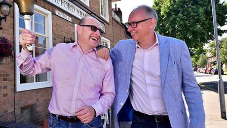Chris Higgins, left, calls time on running The Trafford Arms pub. Pictured with new landlord Nick De