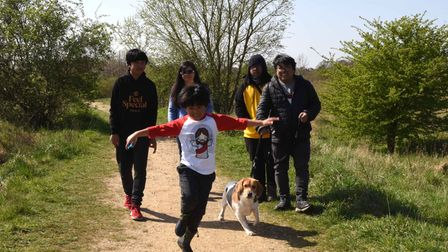 A family out enjoying the walking trails around Eastbrookend Country Park