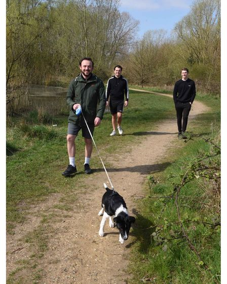 Connor, Kieran and Jamie with Max the dog enjoying a walk in Eastbrookend Country Park in Dagenham o