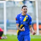 Kairo Mitchell wheels away after giving King's Lynn the lead against Altrincham