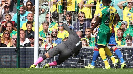 Try as he might, John Ruddy had little chance of keeping Wilfried Zaha's close-range opener out. Pic