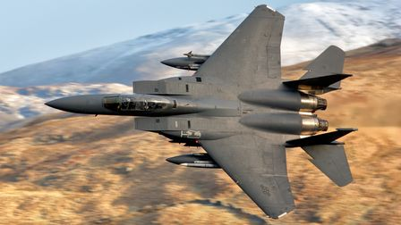 An F-15 of the 492nd Fighter Squadron, based at RAF Lakenheath, flying through the Mach Loop in Wale
