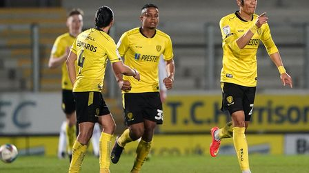 Burton Albion's Sean Clare (right) celebrates scoring their side's first goal of the game with team-