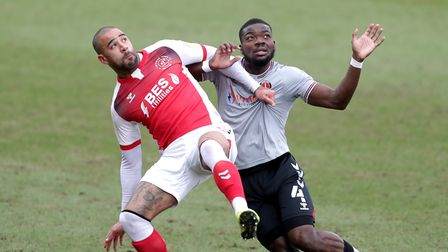 Fleetwood Town's Kyle Vassell (left) and Charlton Athletic's Deji Oshilaja battle for the ball durin