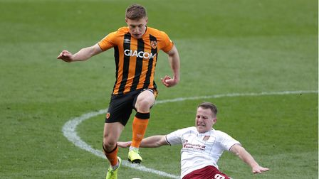 Hull City's Greg Docherty gets away from Northampton Town's Bryn Morris during the Sky Bet League On