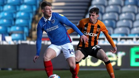 Portsmouth's Andy Cannon (left) and Hull City's Gavin Whyte battle for the ball during the Sky Bet L