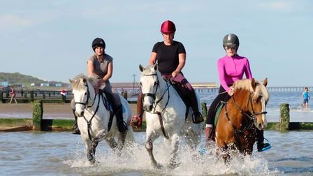 Jacky Wild, Emma Overtonand daughter Leah Hayes horse riding at Frinton beach, where it is now banned.