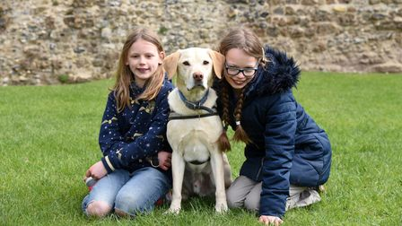 Seren, Emily and Teal the dog. People are enjoying the Easter Trail at Framlingham Castle Picture: