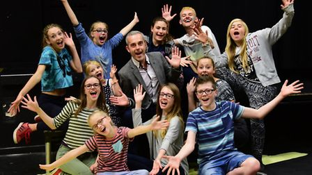 Some of the cast of The Wizard if Oz with chief executive Darren Grice, who is leaving after being a