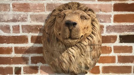 One of the lions watching over The Lion in East Bergholt, formerly The Red Lion, which has been newl
