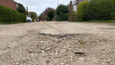 Extensive and deep pot holes at Upherds Lane, Ely