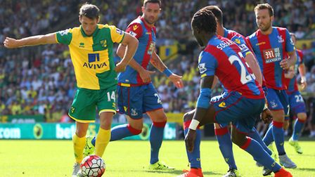 Wes Hoolahan takes on half the Crystal Palace team. Picture by Paul Chesterton/Focus Images Ltd