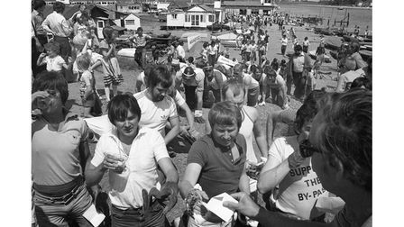 People taking part in a sponsored crawlduring the annual RNLI day at Felixstowe Ferry in June 1978